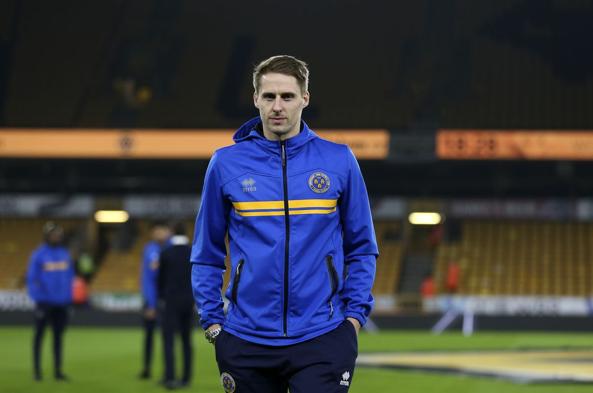 Dave Edwards of Shrewsbury Town looks at the pict before kick off. (AMA)