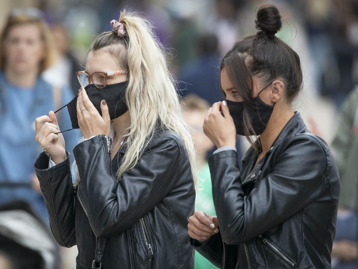 Shoppers wear protective face masks