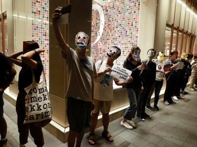 Hong Kong protesters don cartoon faces to defy mask ban