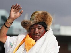 Sherpa scales Mount Everest for record 23rd time