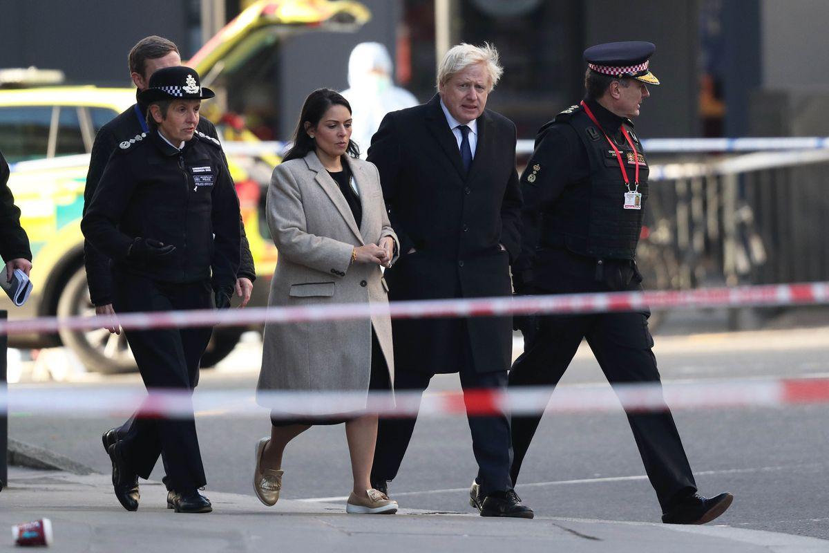 Metropolitan Police Commissioner, Cressida Dick (left), Home Secretary, Priti Patel, Prime Minister Boris Johnson and Commissioner of the City of London Police, Ian Dyson (right) attend the London Bridge crime scene. Credit: Steve Parsons/PA Wire