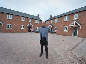 LAST PIC /  DAVID HAMILTON PIC / SHROPSHIRE STAR PIC 10/6/21 Looking at new affordable houses, Shropshire Rural Housing Association chief executive John Green, at Preston upon the Weald Moors, Telford..