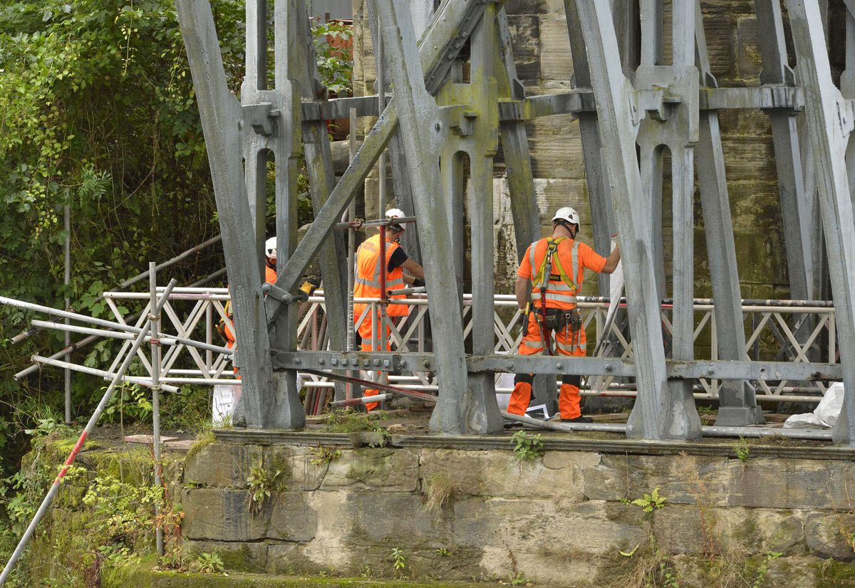 Workers erecting scaffolding on the Iron Bridge