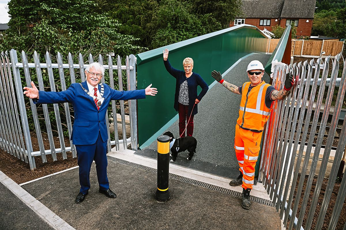 Oakengates Mayor Stephen Reynolds, resident Susan Cotton and site manager Leon Yewdell at the bridge