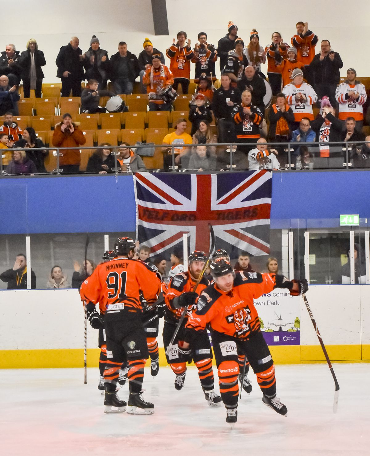 Ricky Plant leads the Tigers to the bench after opening the score for the Tigers