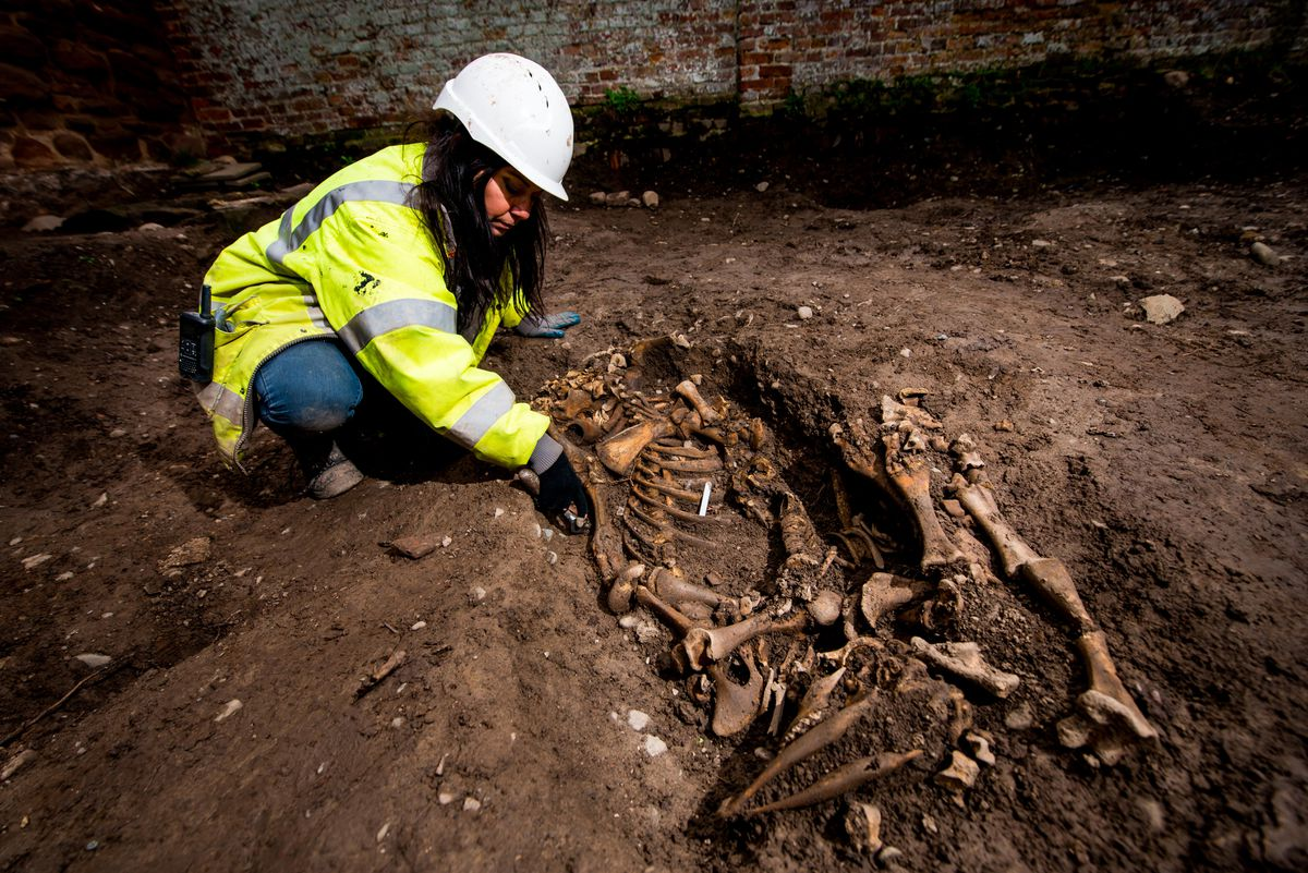Janey Green excavates bones discovered at the site in Shrewsbury