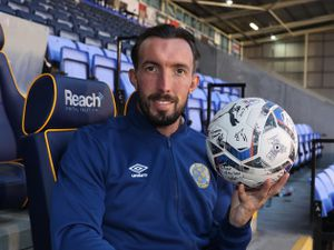 Ryan Bowman of Shrewsbury Town celebrates scoring a hat trick in Town's 4-1 win with the match ball signed by all of his team mates.
