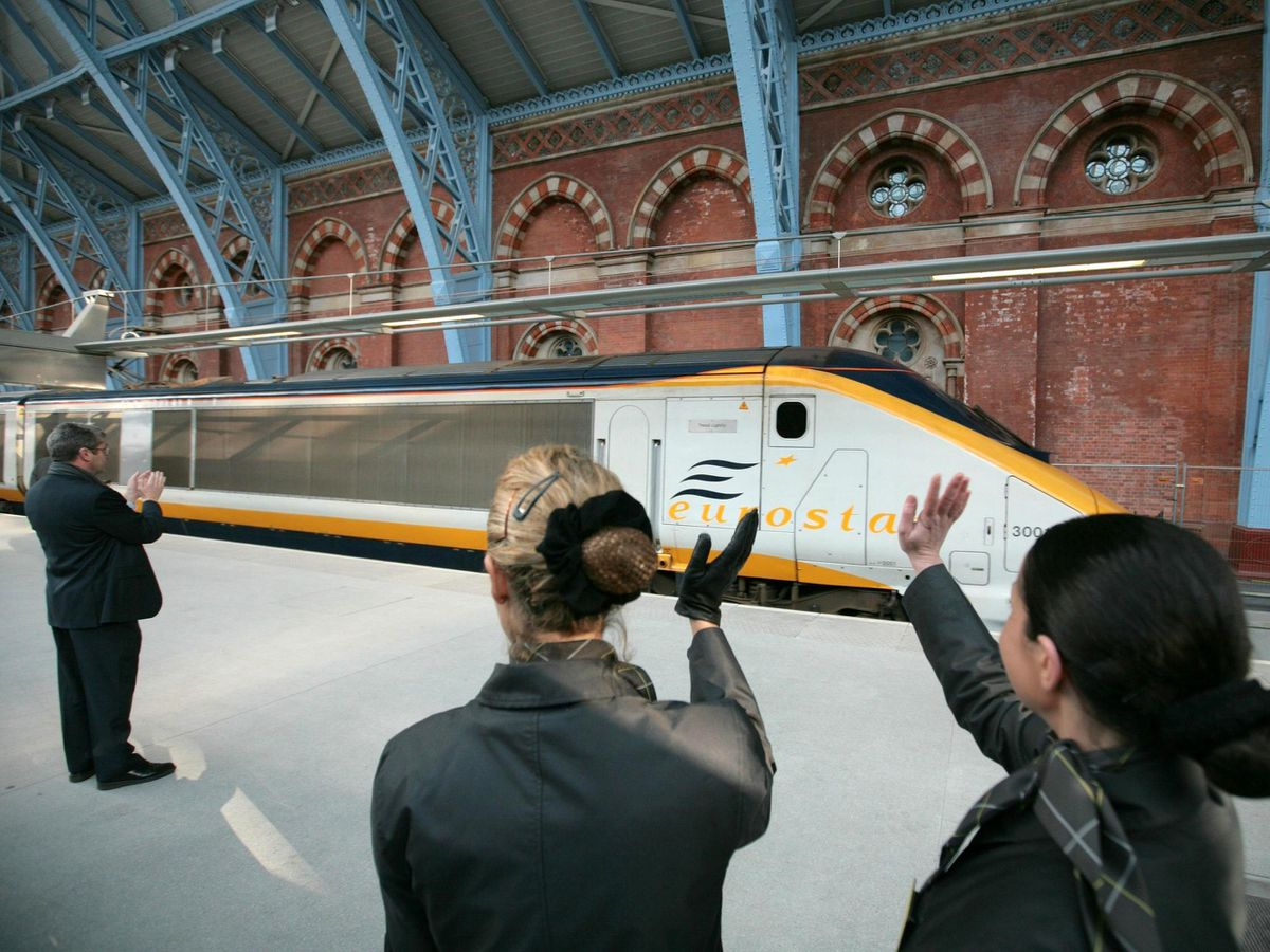 Eurostar staff wave off the first high speed train to Paris at the new terminal at St Pancras station. PRESS ASSOCIATION Photo. Picture date: Wednesday November 14, 2007. London will move a step closer to continental Europe today when Channel Tunnel train company Eurostar starts faster-than-ever services to Paris and Brussels from a new international terminal. See PA story RAIL Eurostar. Photo credit should read: Andrew Parsons/PA Wire