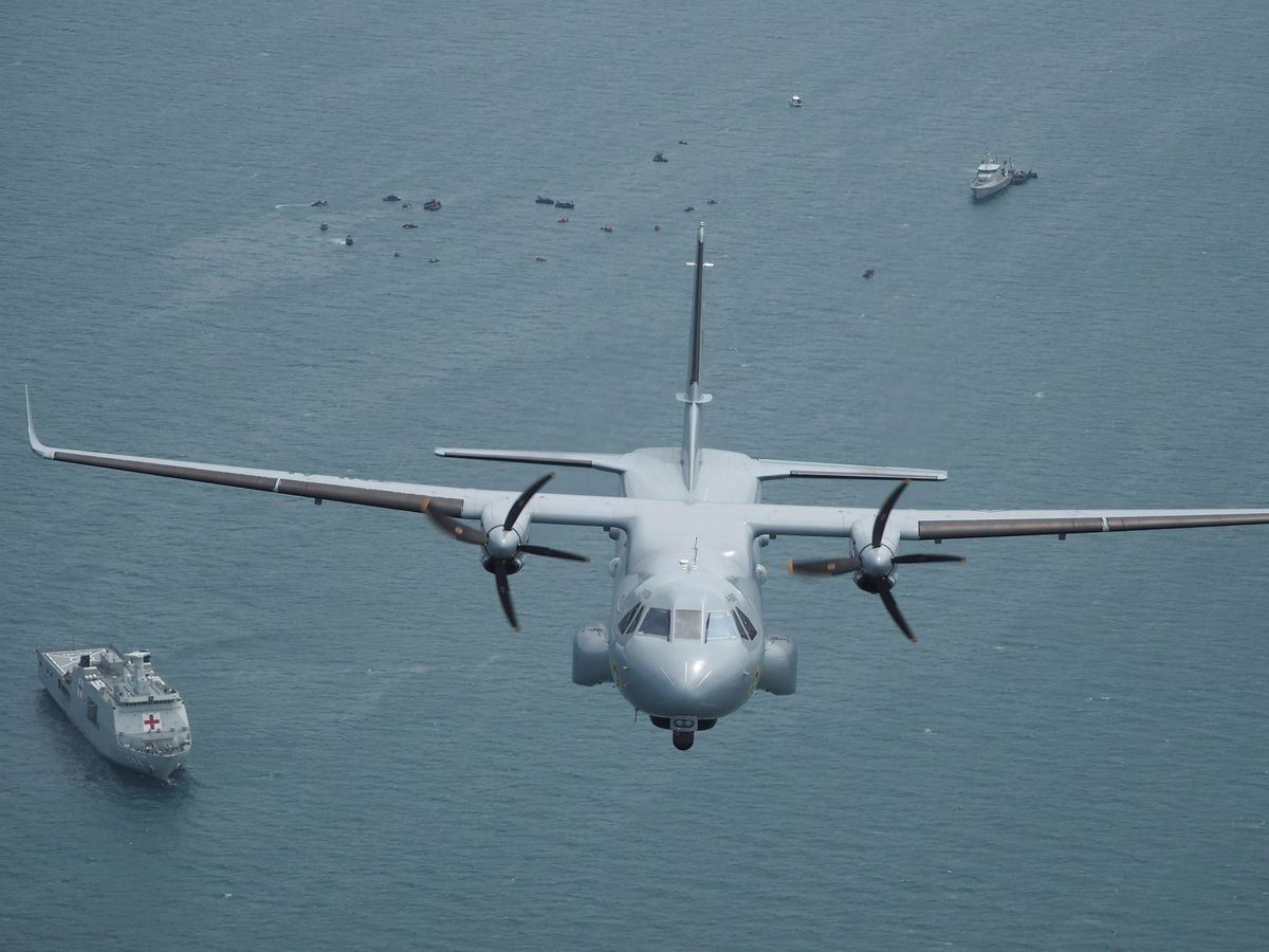 Indonesian Navy aircraft flies as the search for the wreckage of a crashed Sriwijaya Air passenger jet continues (Eric Ireng/AP)