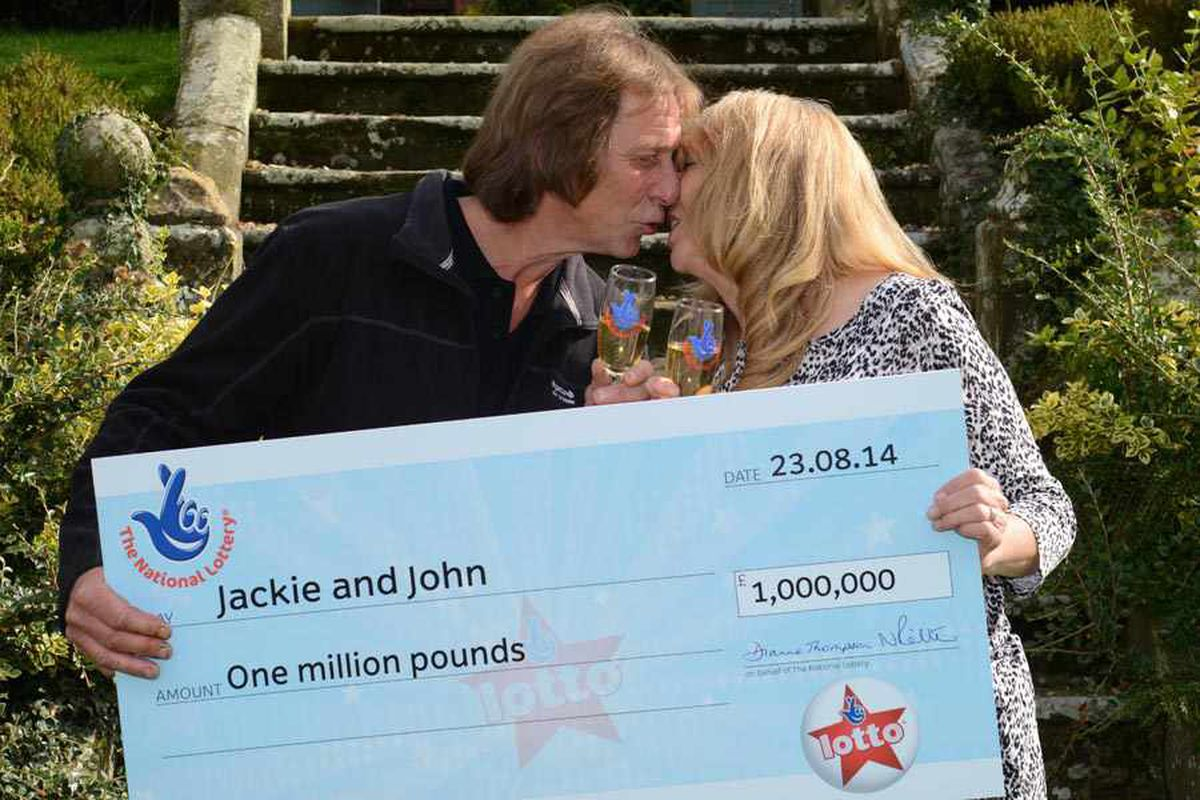John Porter and Jackie Murphy celebrate their Lottery win