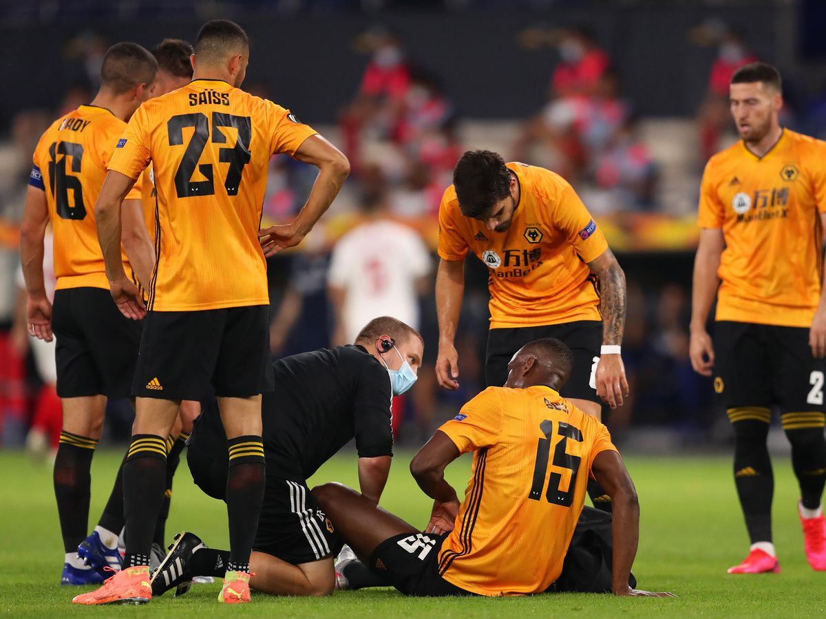 Danny Fishwick treating Wolves defender Willy Boly last season