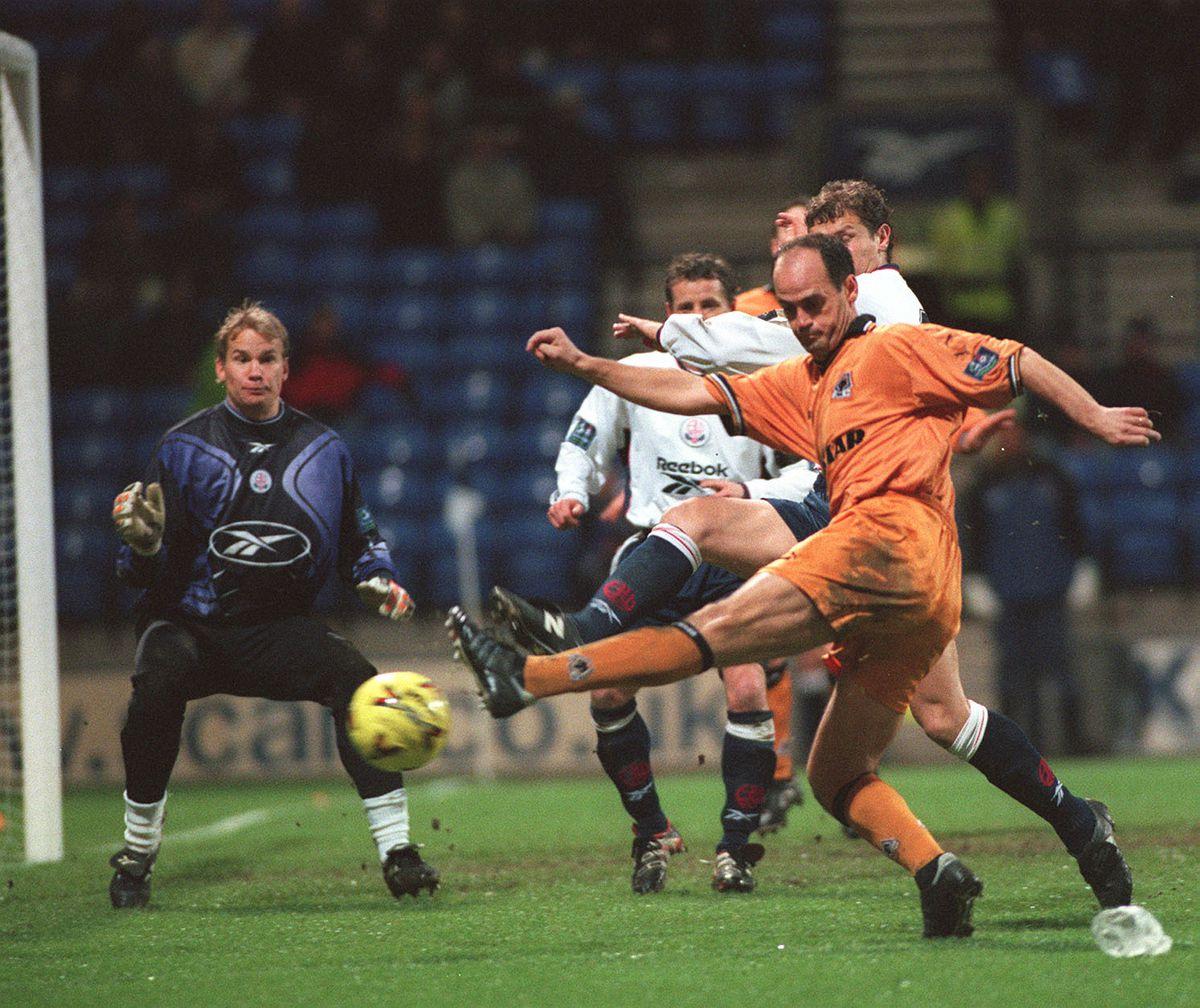 Bolton goalkeeper Jussi Jaaskelainen looks a worried man as Wolves Spanish midfielder Fernando Gomez hits the side netting.
