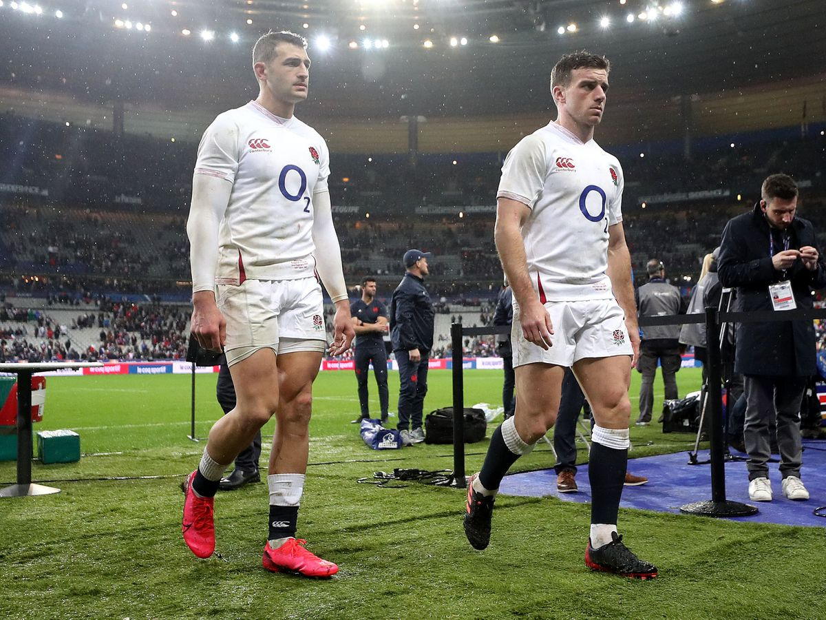 England's Jonny May (left) and George Ford walk off the pitch
