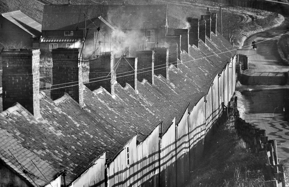 Last days for Dark Lane. The community was destroyed by the development of Telford town centre and the Hollinswood housing estate. This picture dates from January 1965. Dark Lane Methodist Chapel is in the background. These houses were known as Bottom Row.
