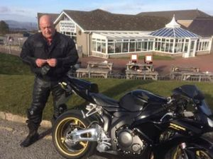 Mr Michael Williams and his motorbike on a visit to the Ponderosa cafe at Llangollen, a popular spot for motorcyclists