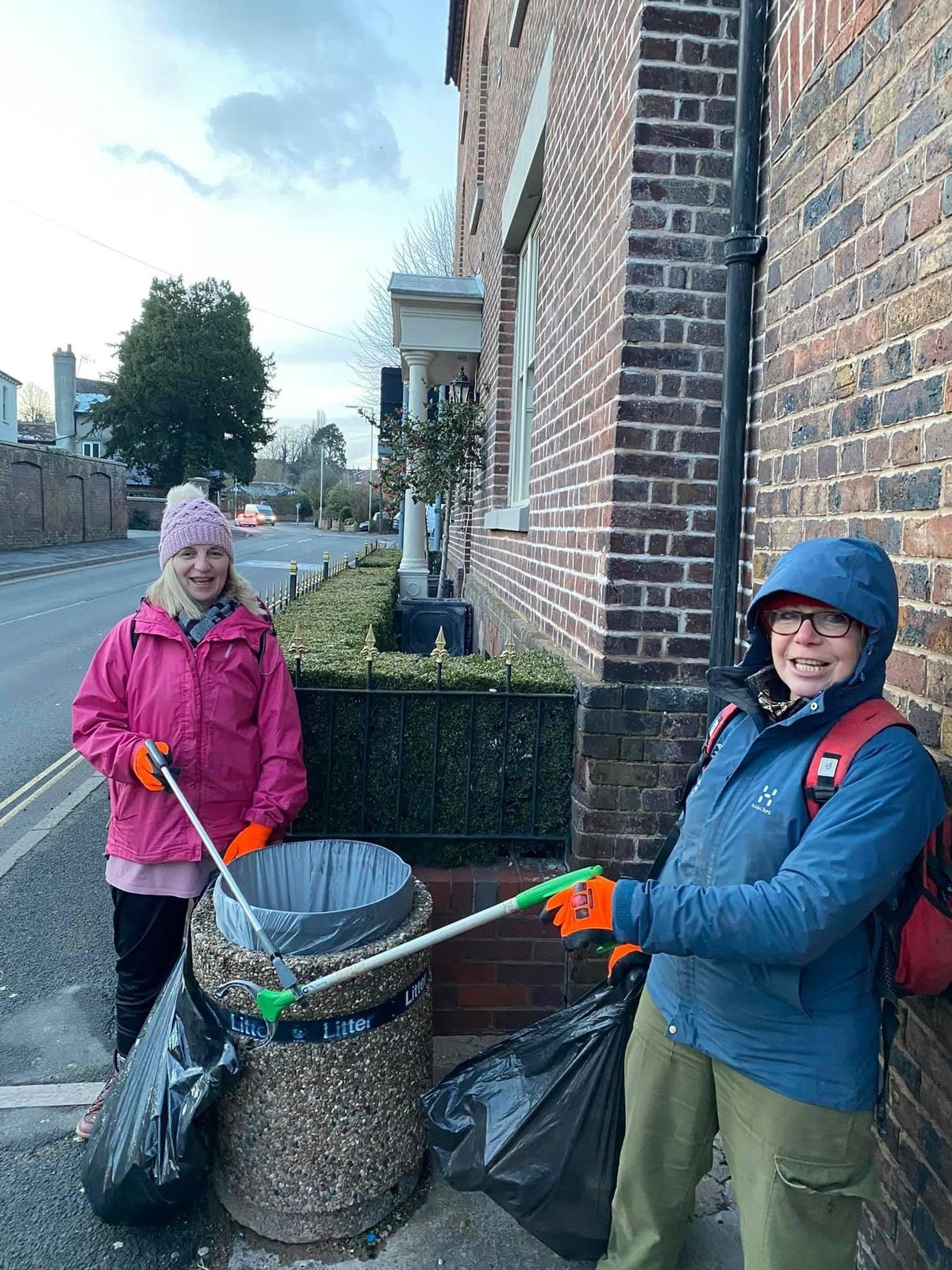 Residents Helen Bevers and Liz Rochelle clean Salop Street