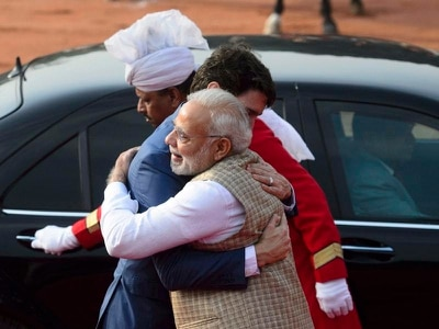 Hug for Trudeau from Modi amid embarrassment over party invitation for convict