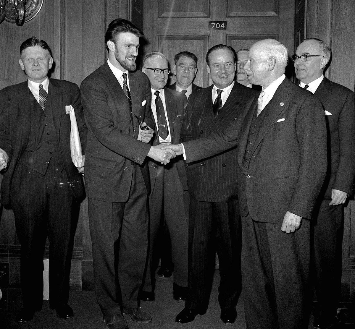 Player's leader Jimmy Hill, left, with beard, changed the face of of football forever in talks over the winter of 1960 to 1961. He is pictured shaking shaking hands with Joe Richards, President of the Football League, after a meeting which led to a players' strike being called off.