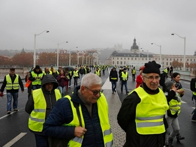 One killed and dozens injured in French fuel tax protests