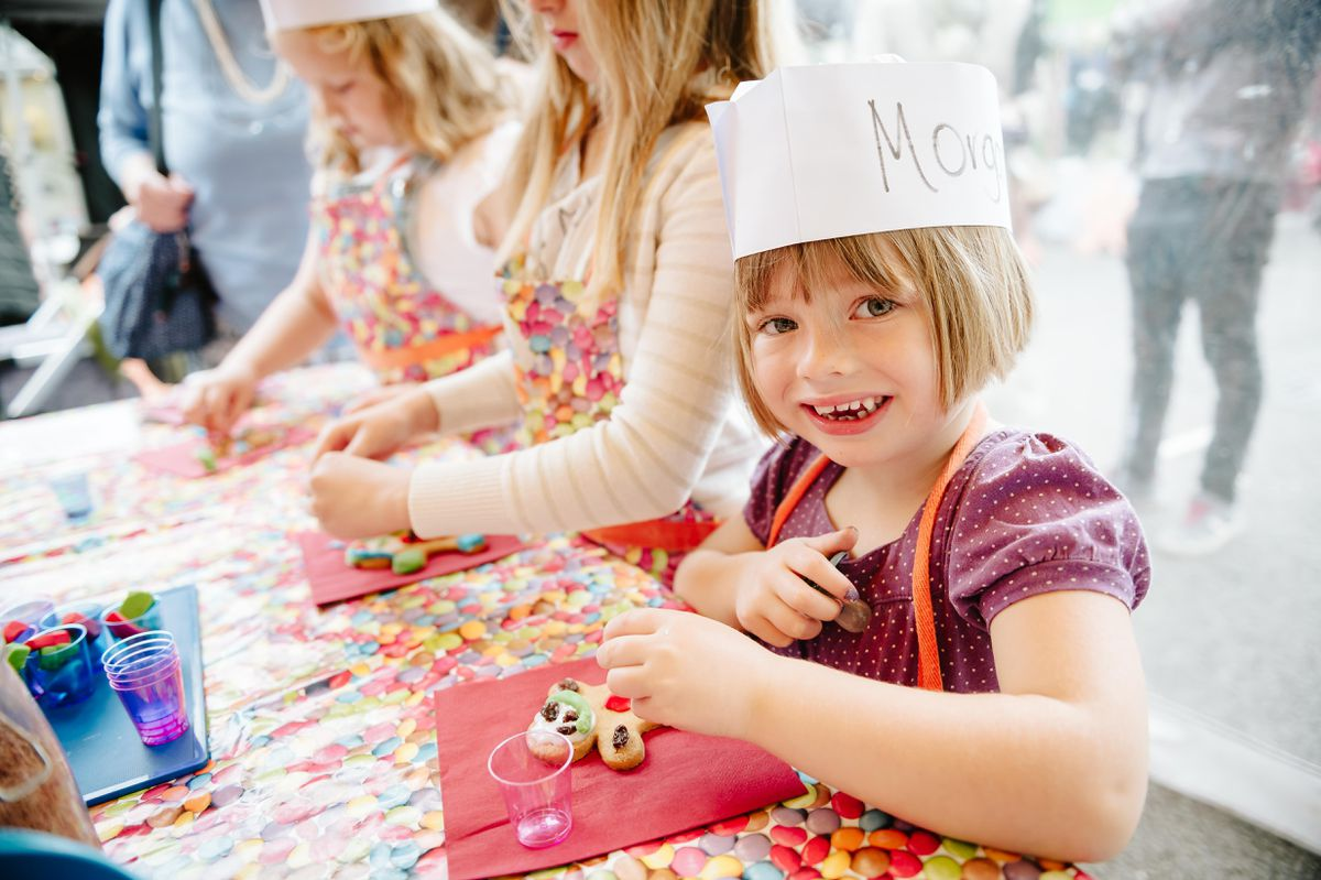 Morgan Bailey, aged four, decorates a gingerbread at Market Drayton's Ginger and Spice Festival