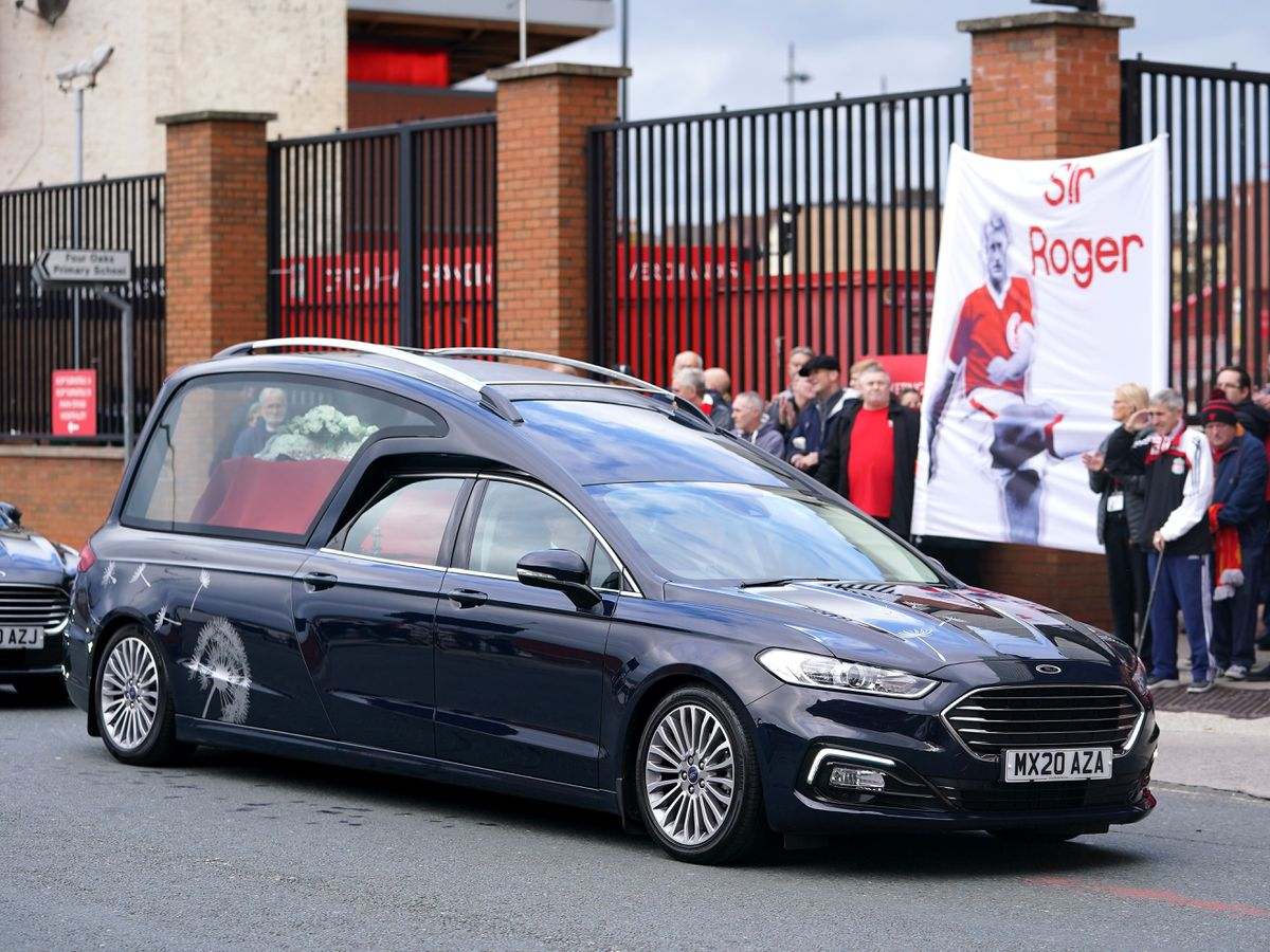 Roger Hunt's funeral cortege pauses outside Anfield