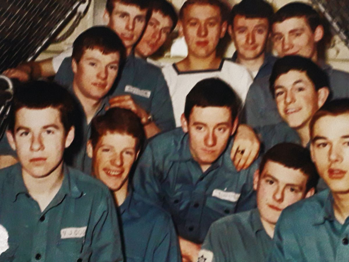 John, front, extreme left, with some of his mates in the Royal Navy, in a picture he thinks was taken on the aircraft carrier HMS Hermes.