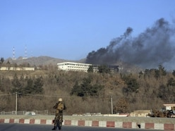 At least 18 killed in gun attack on luxury hotel in Afghan capital