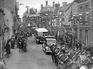 "nostalgia pic. Church Stretton. ""War blinded expatriated prisoners in Church Stretton on their way to St Dunstan's' is the caption handwritten in ink on the back of this print, which has the date stamp of October 29, 1943. Written separately in pencil is 'War blinded in Church Stretton.' It was published in the E&S on  Friday, October 29, 1943. The caption was: 'This was how Church Stretton welcomed 23 blinded prisoners from Germany when they arrived yesterday to go to St Dunstan's.' St Dunstan's was an institution for blinded servicemen in the town at the time. Church Stretton parade. They were 23 repatriated POWS. During the Second World War St Dunstan's was evacuated to Church Stretton from Brighton. It is now Blind Veterans UK. It stayed in Church Stretton for six years. The British History online website says: 'On the outbreak of the Second World War St. Dunstan's, the charity for rehabilitating men and women blinded on war service, was evacuated to the town from the south coast and remained until 1946.' Church Stretton general view, street scene. Second World War, World War Two, 1939 to 1945 war. This print is in the basement archive at the Express and Star and was copied in situ on Tuesday, March 9, 2021. There is no copyright stamp but the circumstances point to this being E&S copyright. In the distance is The Hotel and extreme left is The Square and a glimpse of Church Stretton Town Hall, which was demolished in the 1960s. Library code: Church Stretton nostalgia 2021.."
