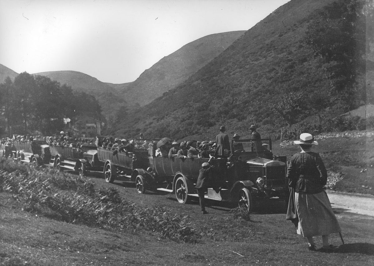 A charabanc invasion of the Carding Mill Valley beauty spot at Church Stretton. While we don't have the date, charabanc travel was very popular around the 1920s – but presumably somewhat less popular if it was raining.