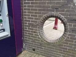 Tripadvisor halts reviews as hole in wall crowned town's top attraction