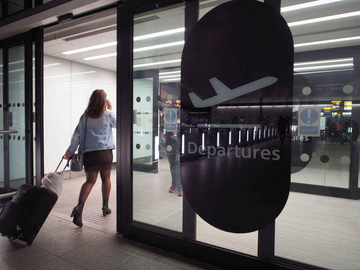 Passengers in Terminal 2 at Heathrow airport a