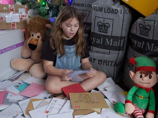 Abbie Paice with the thousands of cards and gifts she has received