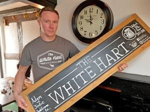 Landlord of the White Hart in Shifnal, Adam Caton gets set for a new closing time after the government impose a 10pm shutdown for pubs