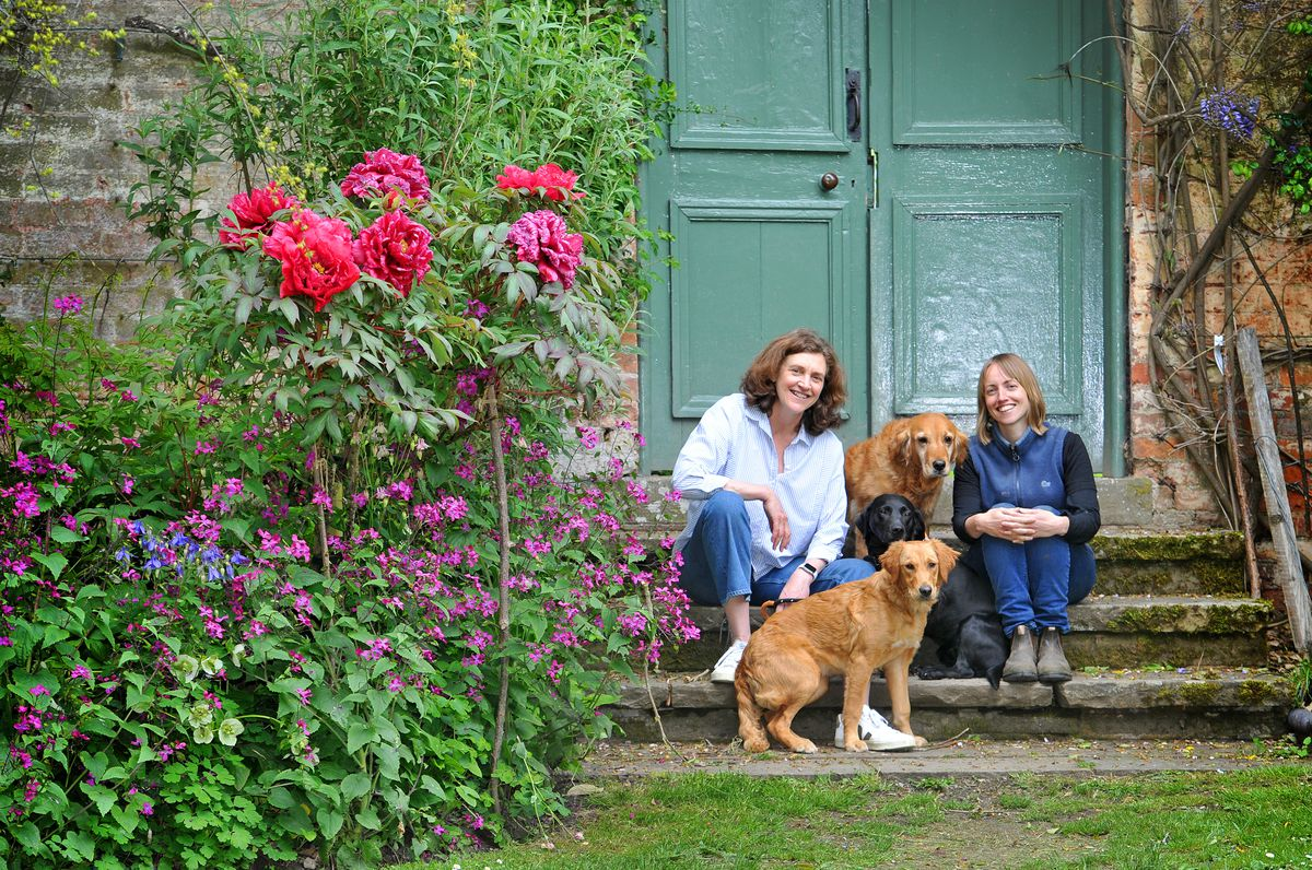 The beautiful gardens are open at Walcot Hall, Lydbury North, this weekend. Pictured are Lucinda Parish and head gardener Laura Stobbart, with dogs Rhona, Luna and Rose