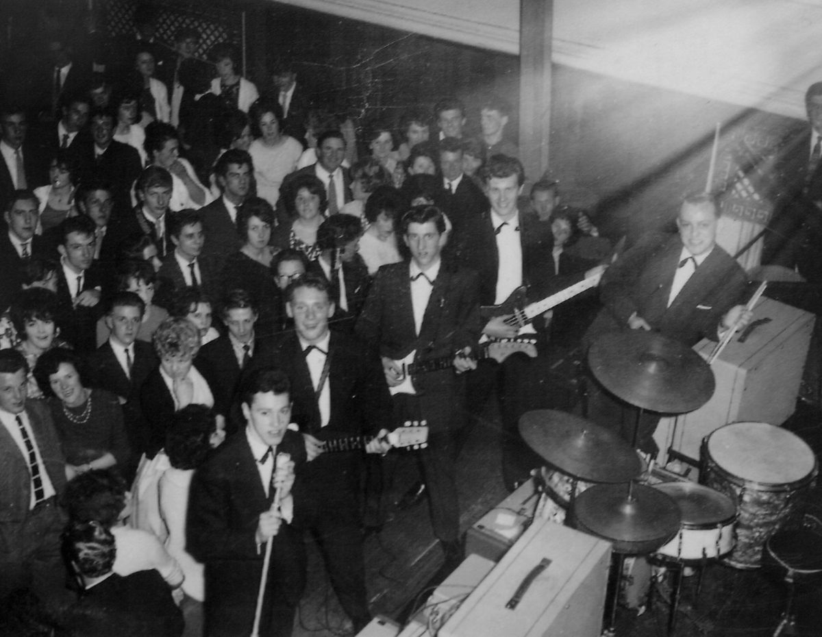 The Deltas during the concert, with Roger third from left in the group line-up.