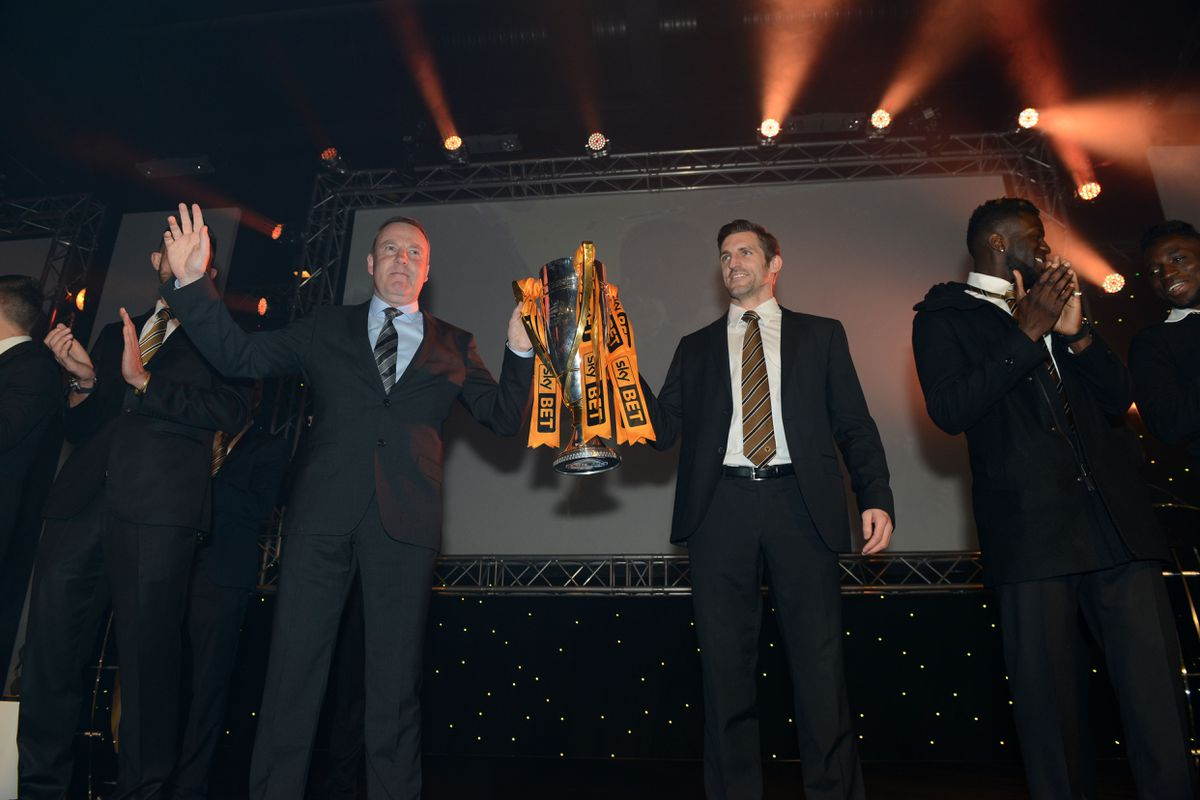 Sam Ricketts with his former manager Kenny Jackett, back in 2014, celebrating his League One promotion with Wolves. (AMA)