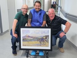 Old pals put Shropshire paralympic archer Mikey in the picture