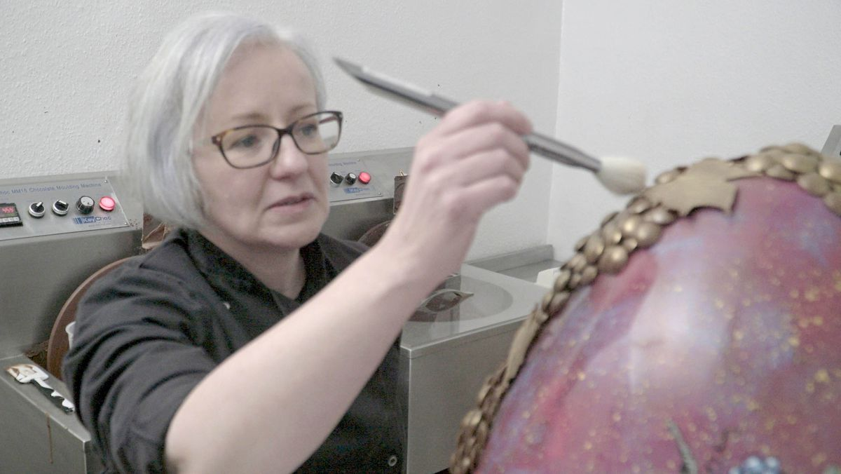 Emma Baravelli applies the finishing touches to the egg