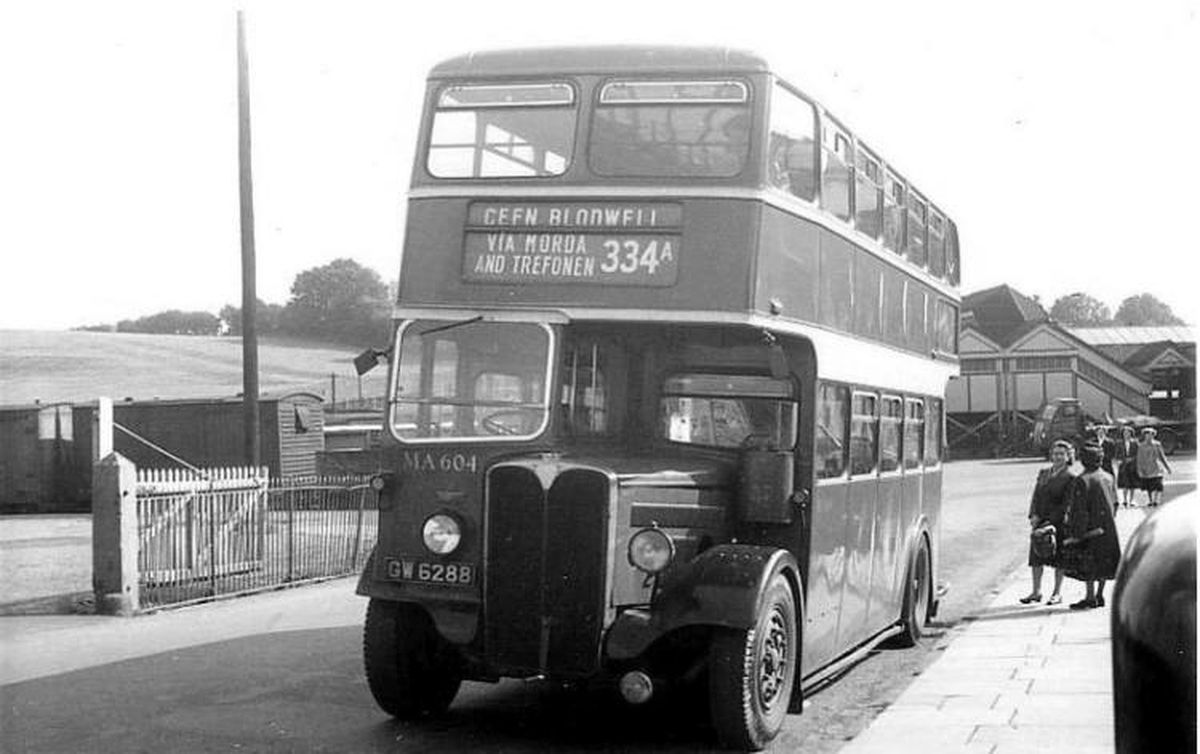 This double decker was in action in Oswestry in about 1954 or 1955. The lady on the pavement looking our way is Mrs Gladys Holmes, who lived at Treflach, and died in 1957 or 1958. The bus is an AEC Regent being operated by Crosville. The location seems to be outside Oswestry railway station. Picture: Bob Hanley.