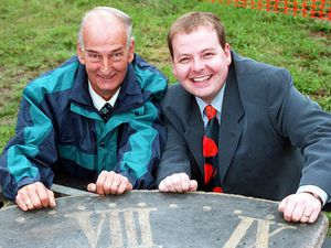 Roy Lane and television presenter Simon Keeling with the historic clock after its return to Broseley in September 1999.