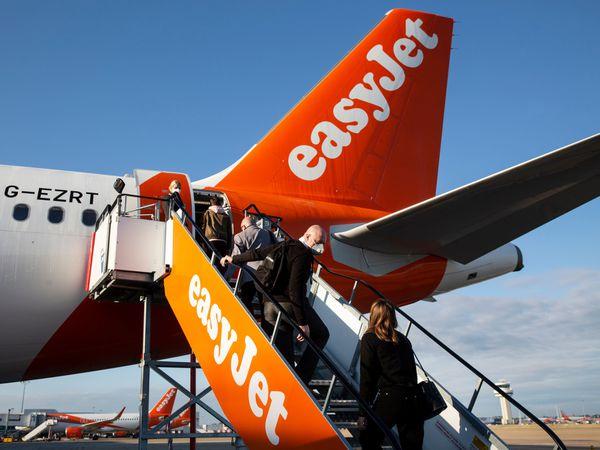 Passengers boarding an easyJet plane