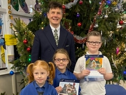 Schoolchildren spread Christmas cheer with card competition