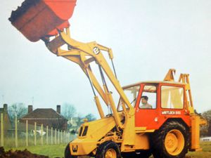 A Whitlock digger in action. This is from the front cover of a book called 'Whitlock Brothers, a history of the family, farms, forage works, foundry and factory at Great Yeldham.'.