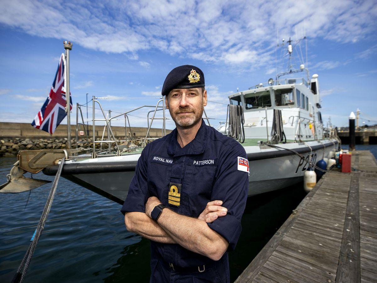 Royal Navy Senior Naval Officer Northern Ireland Commander John Patterson, pictured in front of HMS Biter