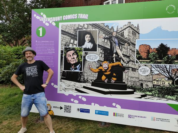 Artist Charlie Adlard with the board depicting his work - it is one of nine across the town which make up the trail. Picture: Comics Salopia