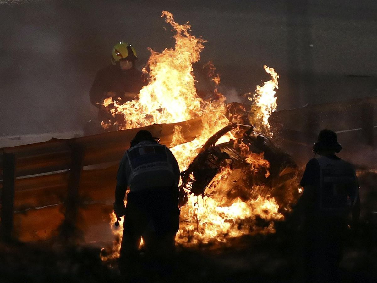 Haas driver Romain Grosjean's car burning after he crashed