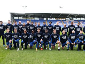 The Shrewsbury Town squad wear a t-shirt saying get well soon to manager Steve Cotterill who has been suffering with the Covid-19 Coronavirus.