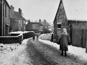"nostalgia pic. Dawley. Dawley street scene, general view, on January 17, 1963. A snowy Dawley street. Snow. Ice. Winter. Freeze up. Wintry weather. This is a print in the Shropshire Star picture archive and handwritten on the back is 'byeroad off Dawley main street.' The print has the Express and Star copyright stamp and the photographer was 'JJ,' which is Johnnie Johnson. His written date on the back is 17.1.63 which will be when he took it. There is no separate datestamp so it's possible this picture was not published. AFTER PUBLICATION WE HAD FOLLOWING FEEDBACK: See that wall on the right? That's where Allan Potter and his mate put their tins cans, and shot at them. And then scarpered at the appearance of police. Allan, who lives in Muxton these days but used to live in Dawley, had no trouble identifying this snowy Dawley road which we featured in Picture From The Archive the other day. The photo was taken in January 1963. ""I'm 100 per cent certain that it's Meadow Road,"" said Allan, who will turn 80 in August. ""It ran from the High Street down to by the Royal cinema. I used to put a tin can on that wall on the right with a friend of mine and shoot at it with an air rifle. I lived in Portley Road and he lived at the back of the High Street and his name was Milvert Lloyd. ""One day while we were shooting a policeman rode past on his push bike. We ran like hell."" Library code: Dawley nostalgia 2021.."