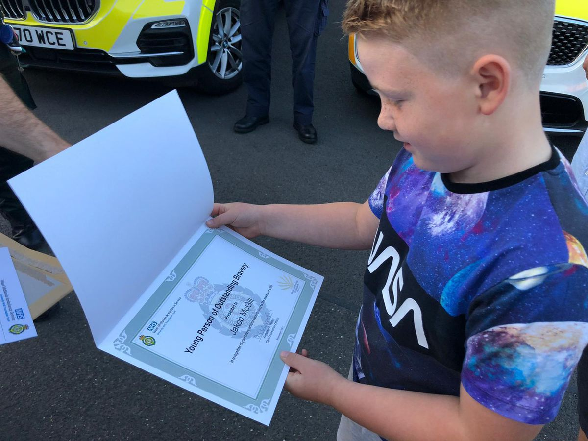 Jakob with his award for bravery