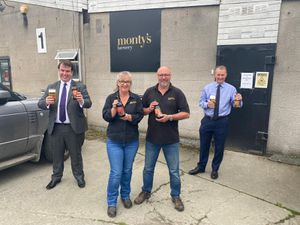 Staff at Monty's brewery with Craig Williams MP and minister Simon Hart